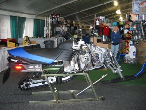 West Yellowstone World Expo show room displays snowmobiles and snowmobile parts & accessories from various aftermarket sellers.