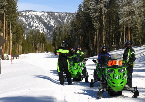 Snowmobile guide leading a snowmobile tour in Yellowstone National Park.