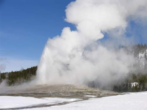 Old Faithful erupting in Yellowstone National Park in the winter of 2009.