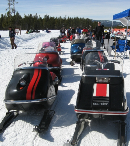 Vintage snowmobiles lined up for a parade at West Yellowstone World Snowmobile Expo (photo taken in 2009 by Linda Aksomitis)